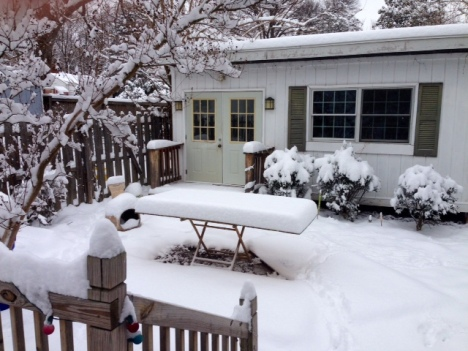 a sad, snow covered flip cup table
